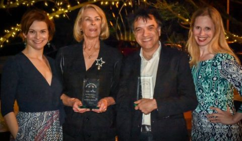 Lance Gharavi and EE Moe accept Persons of The Year awards from Tracy Miller and Brenda Foley